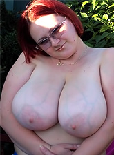 Hot white busty MILF with glasses masturbating in a public place